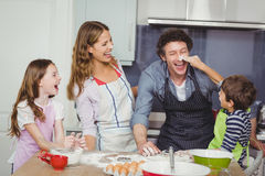 Happy family enjoying while cooking food Stock Photography