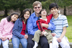 Happy family enjoying day at park Stock Photography
