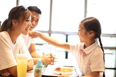 Happy family enjoying dinner in restaurant. Stock Images