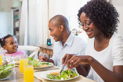 Happy family enjoying a healthy meal together Stock Photos
