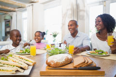 Happy family enjoying a healthy meal together Stock Photography