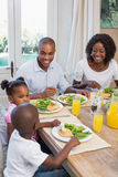 Happy family enjoying a healthy meal together Royalty Free Stock Photo