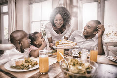Happy family enjoying a healthy meal together. At home in the kitchen stock photography