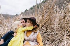 Happy family enjoying life outdoor among the reeds Royalty Free Stock Photos