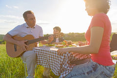 Happy family enjoying lunch outdoors Royalty Free Stock Photography