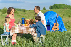 Happy family enjoying lunch outdoors Royalty Free Stock Images
