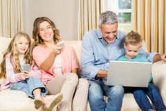 Happy family enjoying a movie together Royalty Free Stock Photography