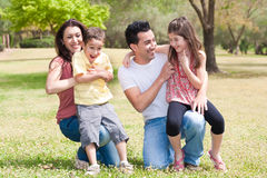 Happy family enjoying in a park Stock Photos