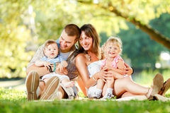Happy family enjoying in the park Royalty Free Stock Image