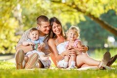 Happy Family Enjoying In The Park Royalty Free Stock Photos