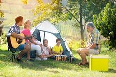 Happy family enjoying picnic royalty free stock images