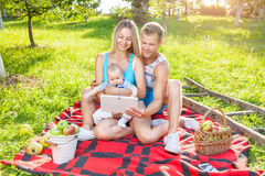 Happy family enjoying a picnic outdoors Stock Images