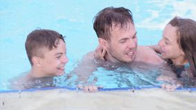 Happy family enjoying in pool stock footage