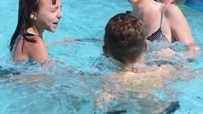 Happy family enjoying in pool stock video footage