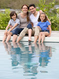 Happy family enjoying by swimming pool Stock Photography