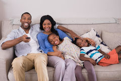 Happy family enjoying television at home. Portrait of happy family enjoying television at home stock image