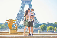 Happy family enjoying their vacation in Paris, France Stock Images