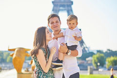 Happy family enjoying their vacation in Paris, France Stock Photos