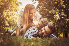 Happy family enjoying together in summer day. stock image