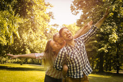 Happy family enjoying together in summer day. Stock Photos