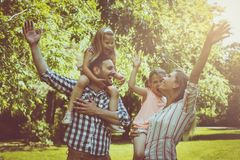 Happy family enjoying together in summer day. Family in nature. Stock Photos