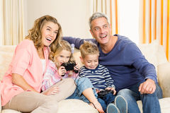 Happy family enjoying video games together Stock Images