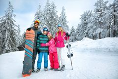 Happy family enjoying in winter vacations stock photography