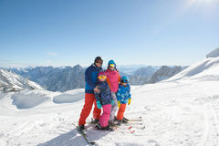 Happy family enjoying winter vacations in mountains . Royalty Free Stock Photo