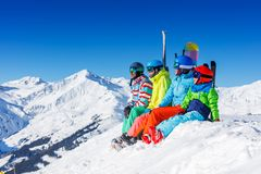 Family enjoying winter vacations in mountains . Ski, Sun, Snow and fun. stock images