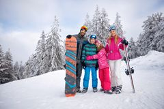 Happy family enjoying in winter vacations together Royalty Free Stock Photo