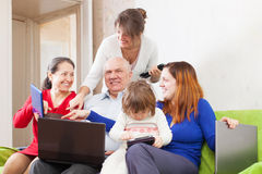 Happy family enjoys  with few laptops Royalty Free Stock Photography