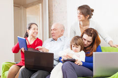 Family enjoys in livingroom room with few laptops Royalty Free Stock Images