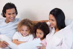 Happy family enjoys reading a story together Royalty Free Stock Images