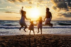 Happy family enjoys their summer vacations stock images
