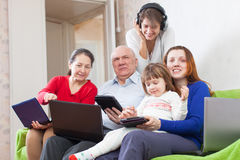 Happy family enjoys  with various laptops at home Stock Photography