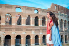 Happy family in Europe. Romantic couple in Rome over Coliseum background. Italian european vacation. Happy family in Rome over Coliseum background royalty free stock image