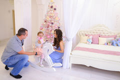 Happy family exchange gifts in spacious bedroom light on backgro Royalty Free Stock Image