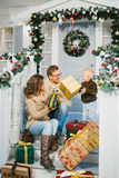 Happy family exchanged Christmas gifts Stock Photography