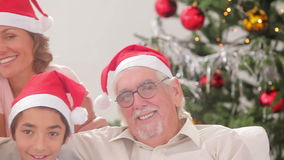 Happy family exchanging christmas presents Royalty Free Stock Image