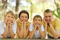 Happy Family faces. Portrait of happy Family faces over natural background Royalty Free Stock Photography
