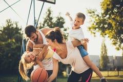 Happy family. Family on basketball court stock photos