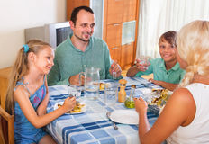 Happy family family dining together Royalty Free Stock Photos
