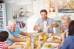 Happy family family having breakfast at home. Happy family having breakfast in kitchen at home Royalty Free Stock Photo