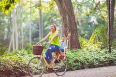 Happy family. Family sport and healthy lifestyle- mother and son. Happy family. Family sport and healthy lifestyle -Happy mother and son riding a bicycle royalty free stock images