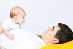 Happy family - father and baby Stock Photos