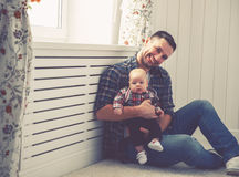 Happy family father and child baby son playing at home Stock Images