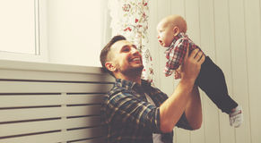 Happy family father and child baby son playing at home. Happy family father and child baby son playing together at home stock image