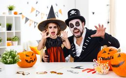 Happy family father and child daughter in costumes   for hallowe Royalty Free Stock Images