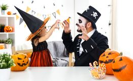 Happy family father and child daughter in costumes   for hallowe Royalty Free Stock Photos