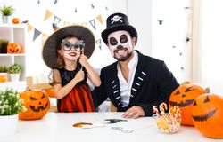 Happy family father and child daughter in costumes   for hallowe Stock Photos